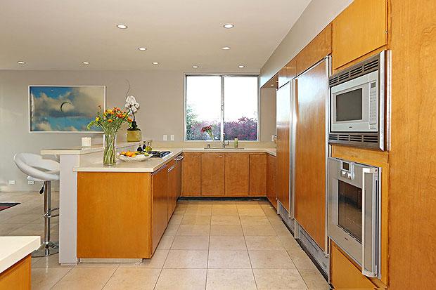The kitchen features Gaggenau appliances, Cesarstone countertops and Sub-Zero refrigerator.