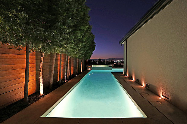 Take a swim in the L-shaped pool, which connects the central garden to the rear of the home and savor the jetliner views or relax in the spa.
