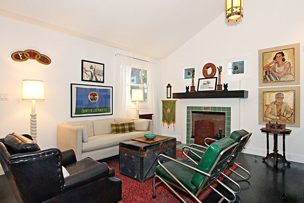 Often, the fireplaces in remodels of older homes are merely cosmetic features rather than functioning units. This one is operational and has been outfitted with a gas starter. And it's handsome.
