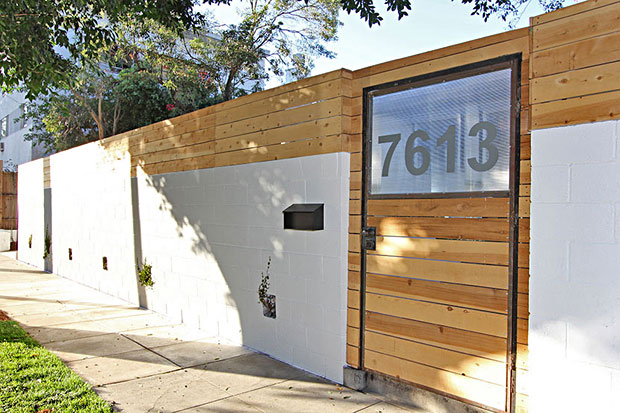 The property has a sense of privacy that's provided by a tall wall and fresh cedar fencing, behind which is gated parking for 3 and a new one-car garage.