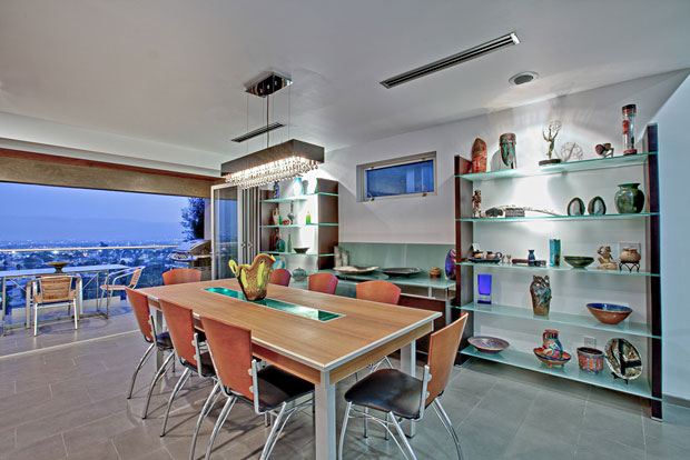 The house is not huge, nor is the lot. But it makes the most of its interior space and is situated to maximize its views. From the downtown skyline to the ocean, there is a view from almost every room.
