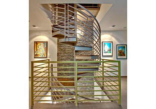 This spiral staircase may look cool, but there's more to it than looks. Winding up from the first floor to the drought-tolerant roof garden, it acts as a thermal flue when the inside heat escapes through the pop-up dome skylight.