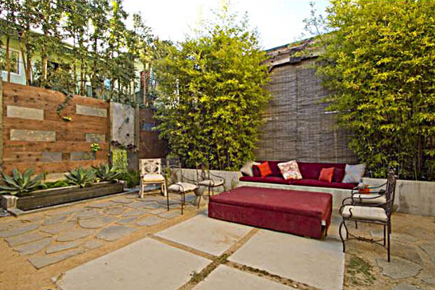 Indoor/outdoor living in this home is enhanced by the privacy provided by high walls and loads of greenery.