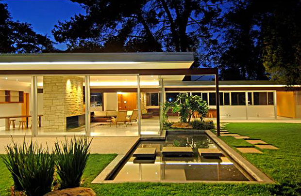 In addition to the swimming pool, the property also includes reflecting pools, another of Neutra's common design elements.