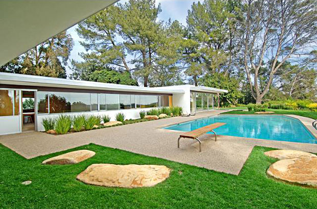 With over five acres of largely level land, there is more than enough room for the large, stylish pool in the backyard.