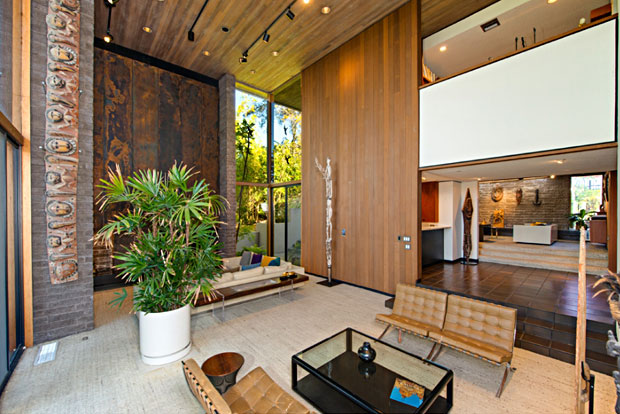 The use of wood, brick, and towering walls of windows give new meaning to 'living large'.