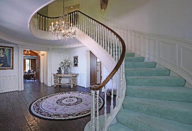 The formal entry hall, with its grand sweeping staircase, welcomes one to the public and entertaining rooms.