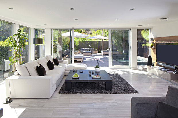 Polished marble floors and massive walls of glass carry you out onto the patio with private pool.