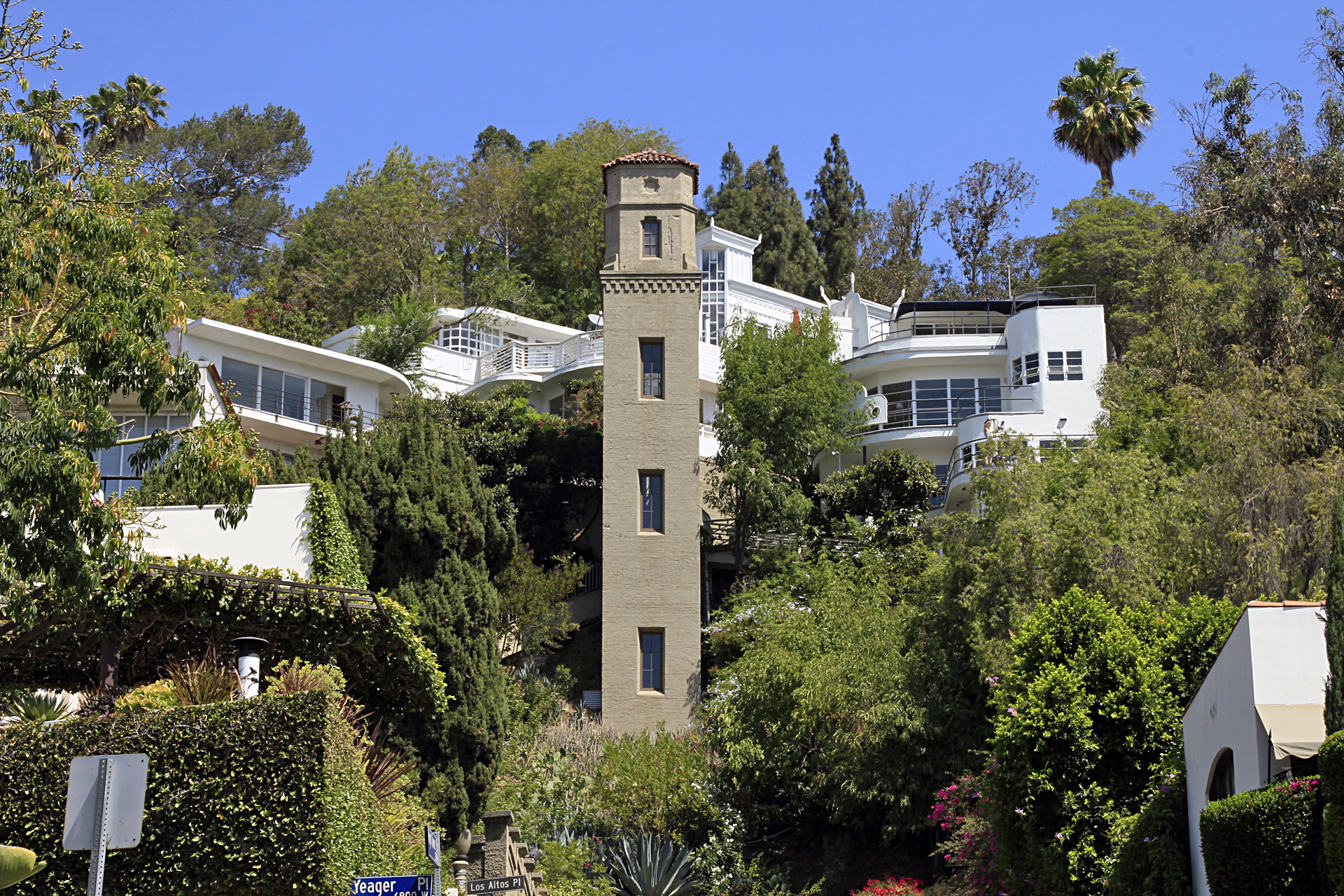 Like a hillside fortress, the Hollywood High Tower is the centerpiece of a small complex of multi-unit residences called High Tower Court, which are built onto the hillside near its top. The homes were built between 1935 and 1956 by architect Carl Kay (1892 – 1973) and the tower itself contains an elevator that provides the residents with quick access to their front door.