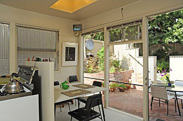 One of the really special things about the home's layout is that there is access to an outside seating area off of every room in the house, including the breakfast nook seen here.