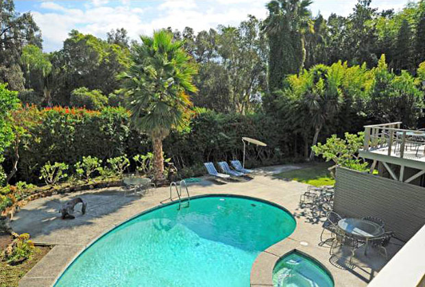 The back yard offers complete privacy and is situated on a manicured and well-landscaped, down-slope lot with views.