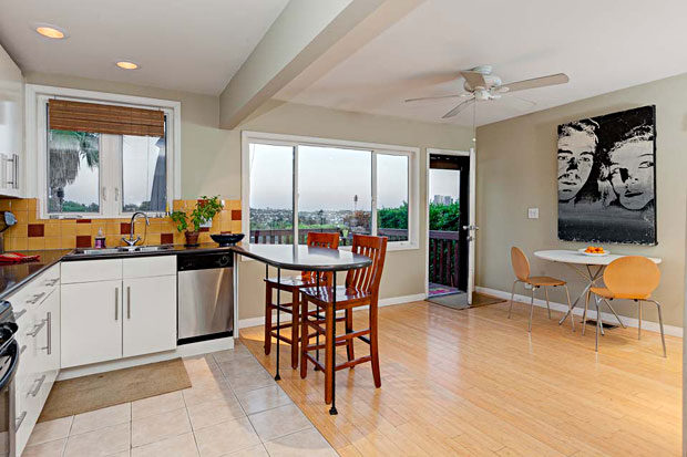 Eco-friendly updates include a tankless water heater, bamboo flooring, Syn-Lawn turf, and energy efficient windows.