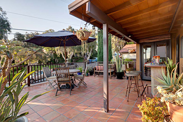 The patio over the garage is a spacious and lovely place to spend an evening with a gathering of friends.