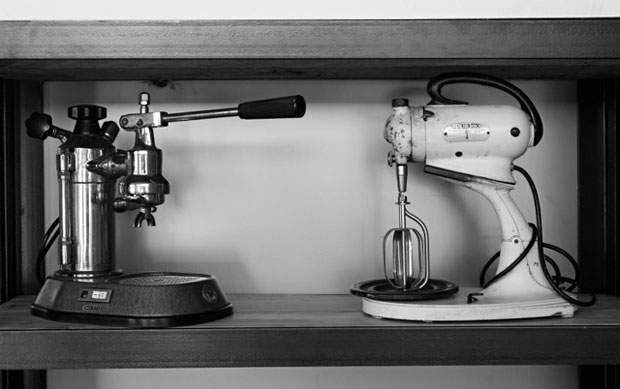 The old-school Pavoni espresso maker and mixer on the shelf lend to the air of home-made goodness here.