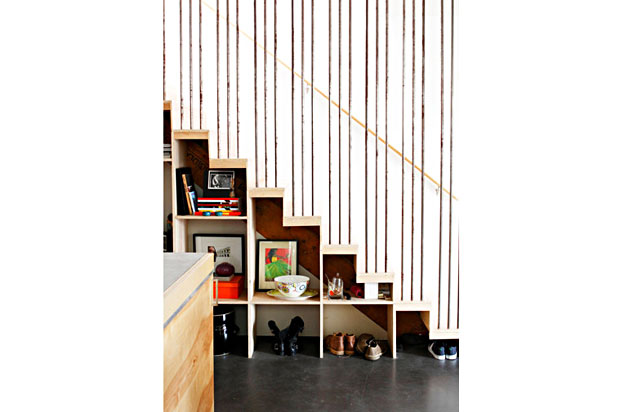 The stairs and the functional storage compartments beneath them are also constructed from plywood.