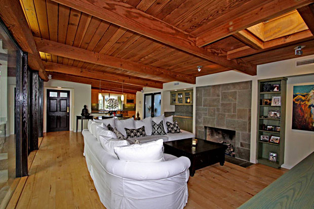 Hardwood floors, wood open-beamed ceilings and natural light are abundant in this home.