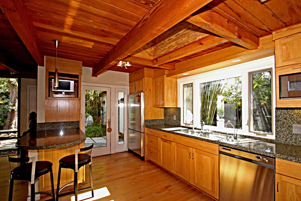The gourmet cook's kitchen which has been updated with Viking appliances, granite counter tops, and custom cabinetry, opens to a great room with French doors leading to a huge entertaining patio.