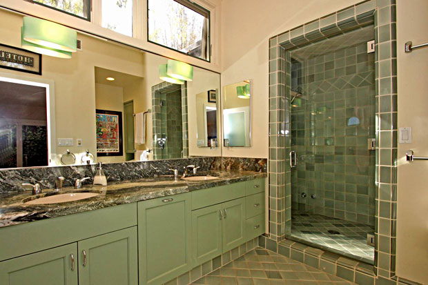 The bathroom features a blend of updated and original finishes.