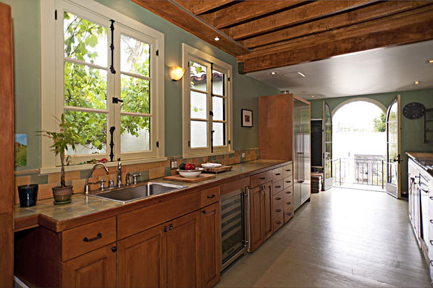 An expansive galley kitchen with easy access to the outdoor areas is perfect for entertaining.
