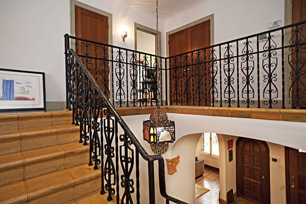The wrought iron railing on the staircase is a work of art in and of itself.