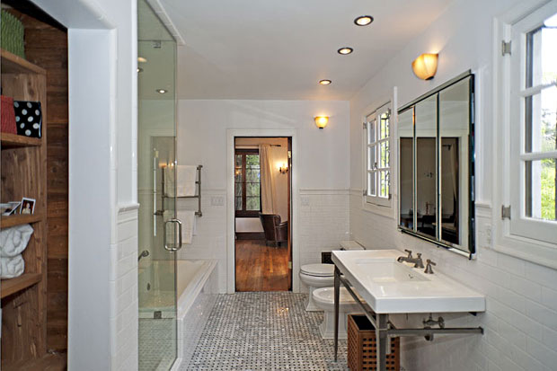 The master bath is highlighted by impeccable tile work.