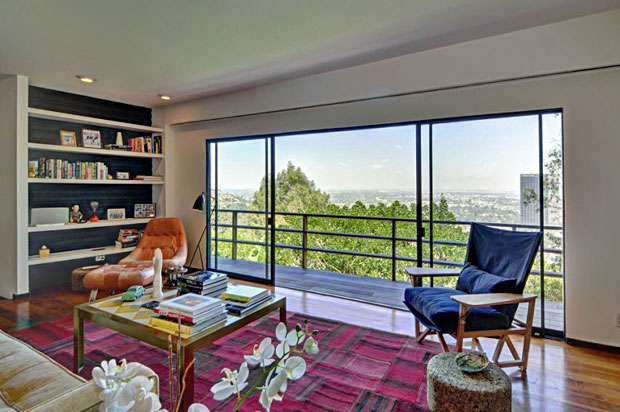 From the living room, there are stunning city, mountain, and sunset views.