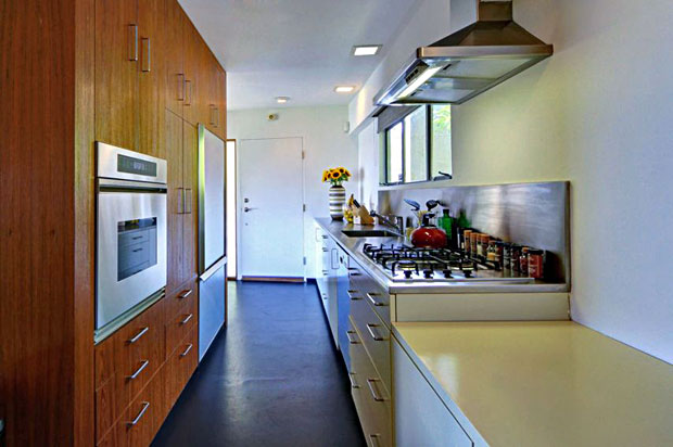 The house's kitchen features beautiful wood cabinetry and work surfaces including stainless steel.