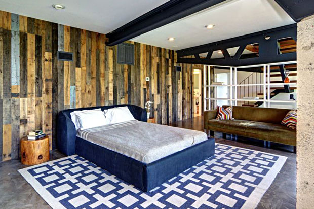... a wall covered with reclaimed wood. Plus, it's huge. There's enough space for an office and exercise area in addition.