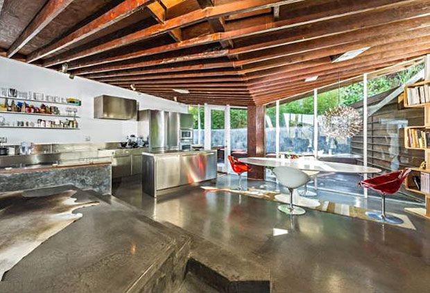 The stylistic open flow allows for the varied angles and corners highlighted by gorgeous concrete floors. The kitchen features stainless steel Polyform, along with Gaggenau and Sub Zero appliances.