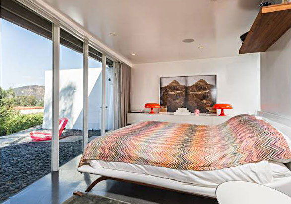The bedroom might feel a little tight except the entire wall opens up to extend the usable space to outside.