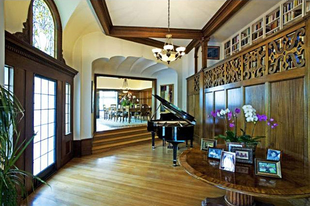 Scalloped ceilings and original woodwork grace the hallways.