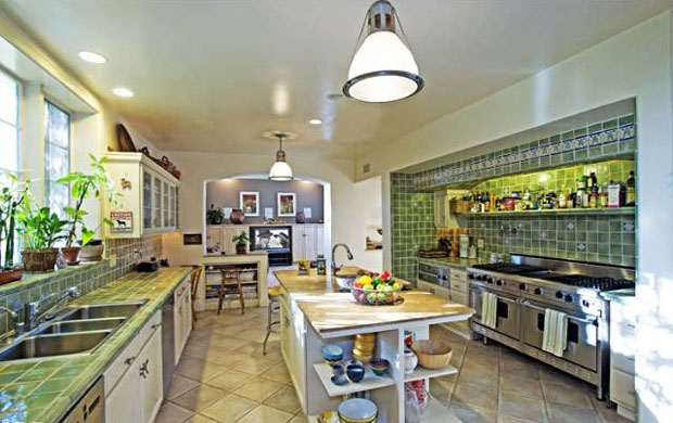 A large chef's kitchen completely updated with modern amenities provides the best of both worlds.