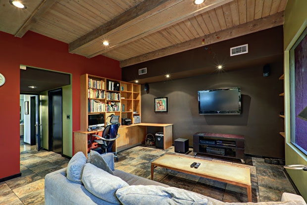 The floating ceiling and tile floors are carried through into the den.