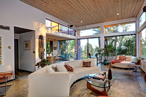 Polished concrete floors, 15' ceilings, large sliding glass doors, and transom windows give the living a very chic feel.