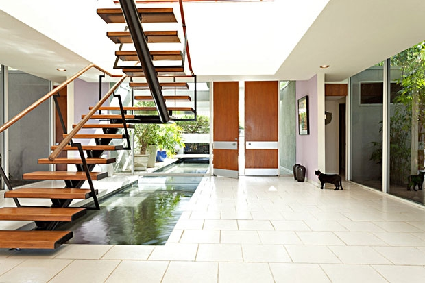 The reflecting pool is beautifully complemented by the floating stairs that rise above it.