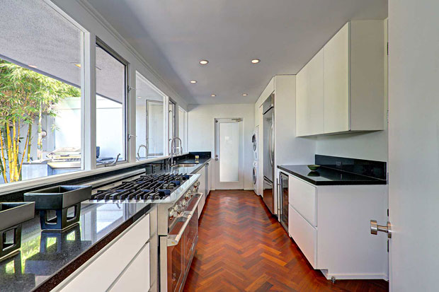The kitchen is beautifully updated, but keeps the parquet floors for continuity with the rest of the house.