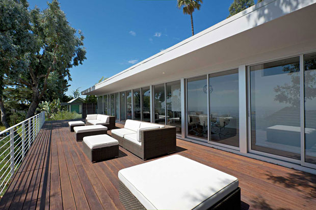 The huge deck fits perfectly sized and its styling matches the house perfectly.