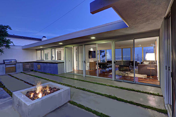 The patio and yard are great for cookouts with an outside sink and barbecue, all centered by a fire pit.