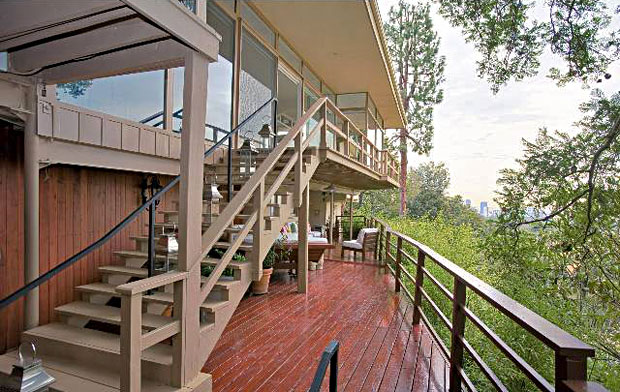 Plenty of space to take enjoy the surrounding views on the multi-level deck runs the length of the house.