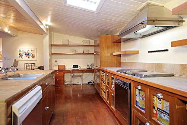 The kitchen with its vintage cabinets and built-ins....