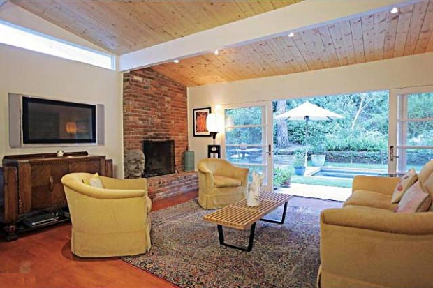 The brick fireplace gives this room charm.