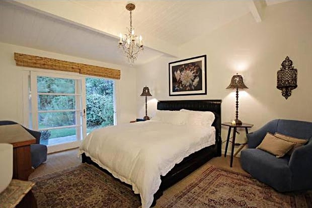 Both of the bedrooms also feature french doors that open to the patio and pool.