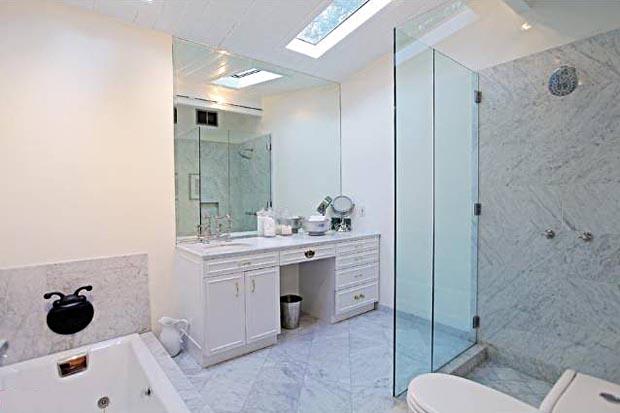 Master bath with step-down tub.