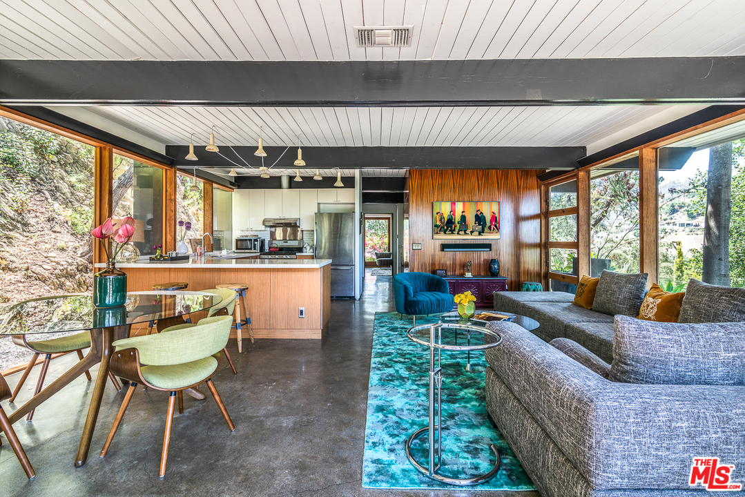 The original bones of the house are all in tact, but it also features a beautifully updated kitchen and bath.  The concrete floors contribute to the home's cool - literally and figuratively.
