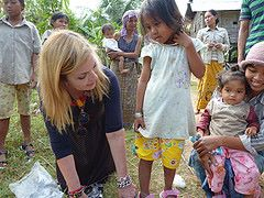 Dr. Suzanne Levine helping a young girl to find the right size.