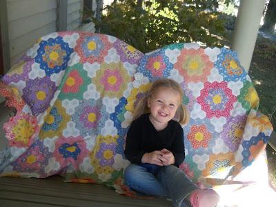 little girl grandmother flower garden quilt.jpeg