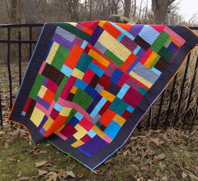 solid fabric improv quilt fence.jpeg