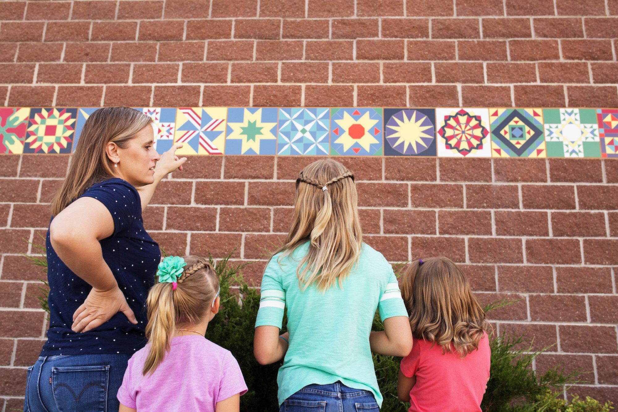 Leila Gardunia showing her children quilt block mosaics at Iowa State Fair copy.jpg