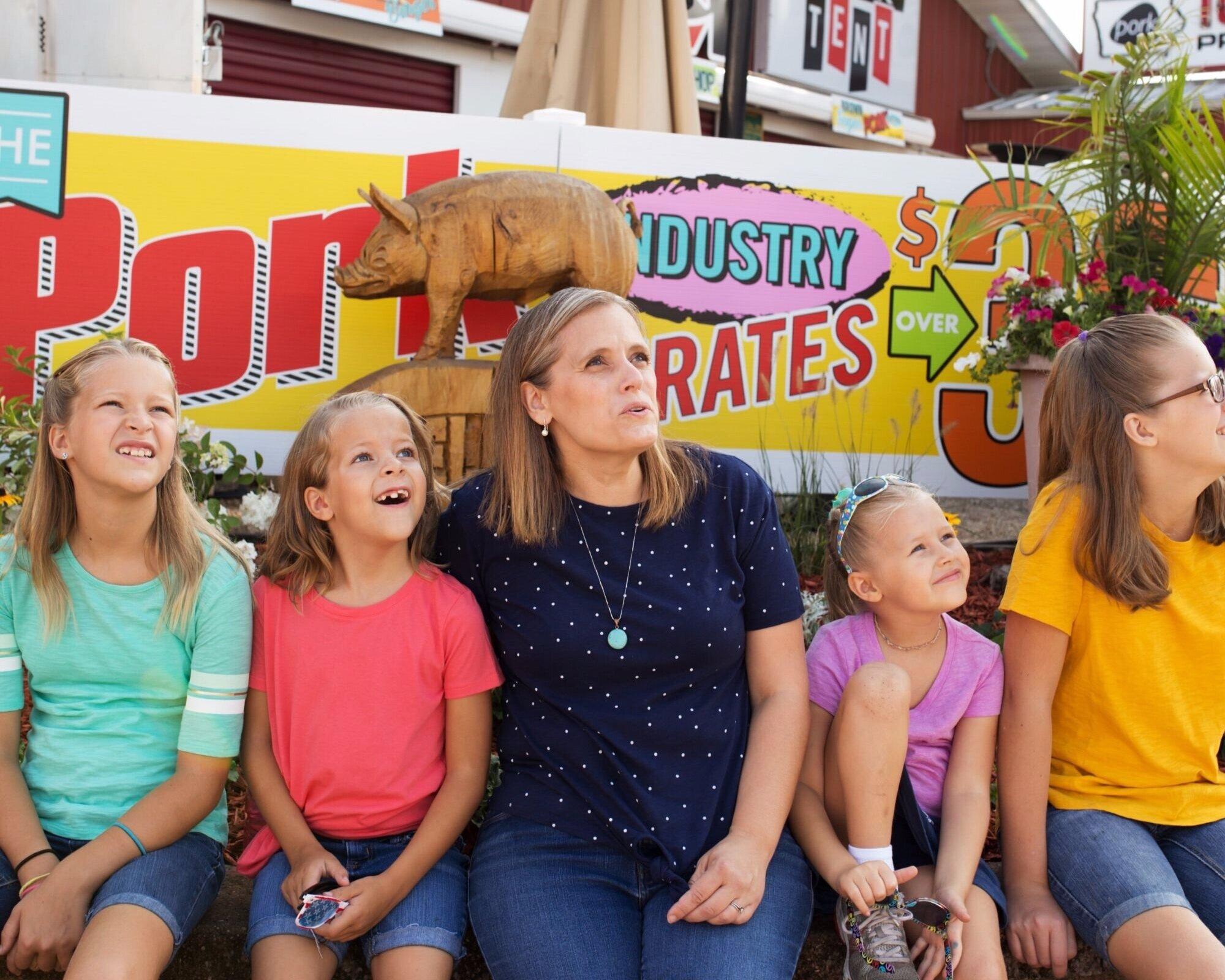 Leila Gardunia and daughters at the Iowa State Fair.jpg