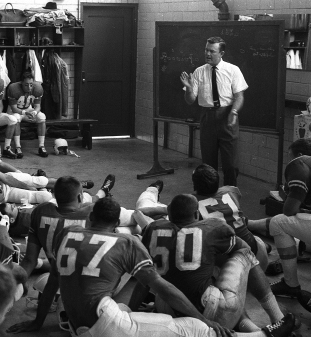 Chapter 48-8 Coach Royal address his players early 60s in Locker Room - 300px.jpg